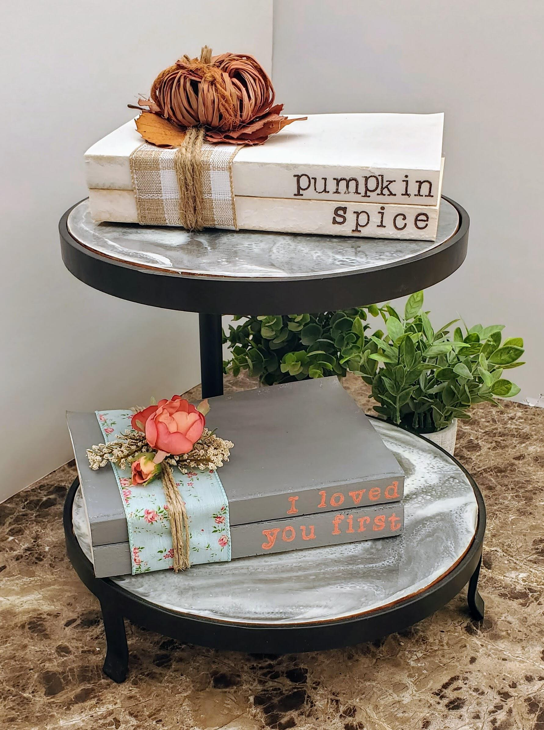 stacked books with plaid ribbon