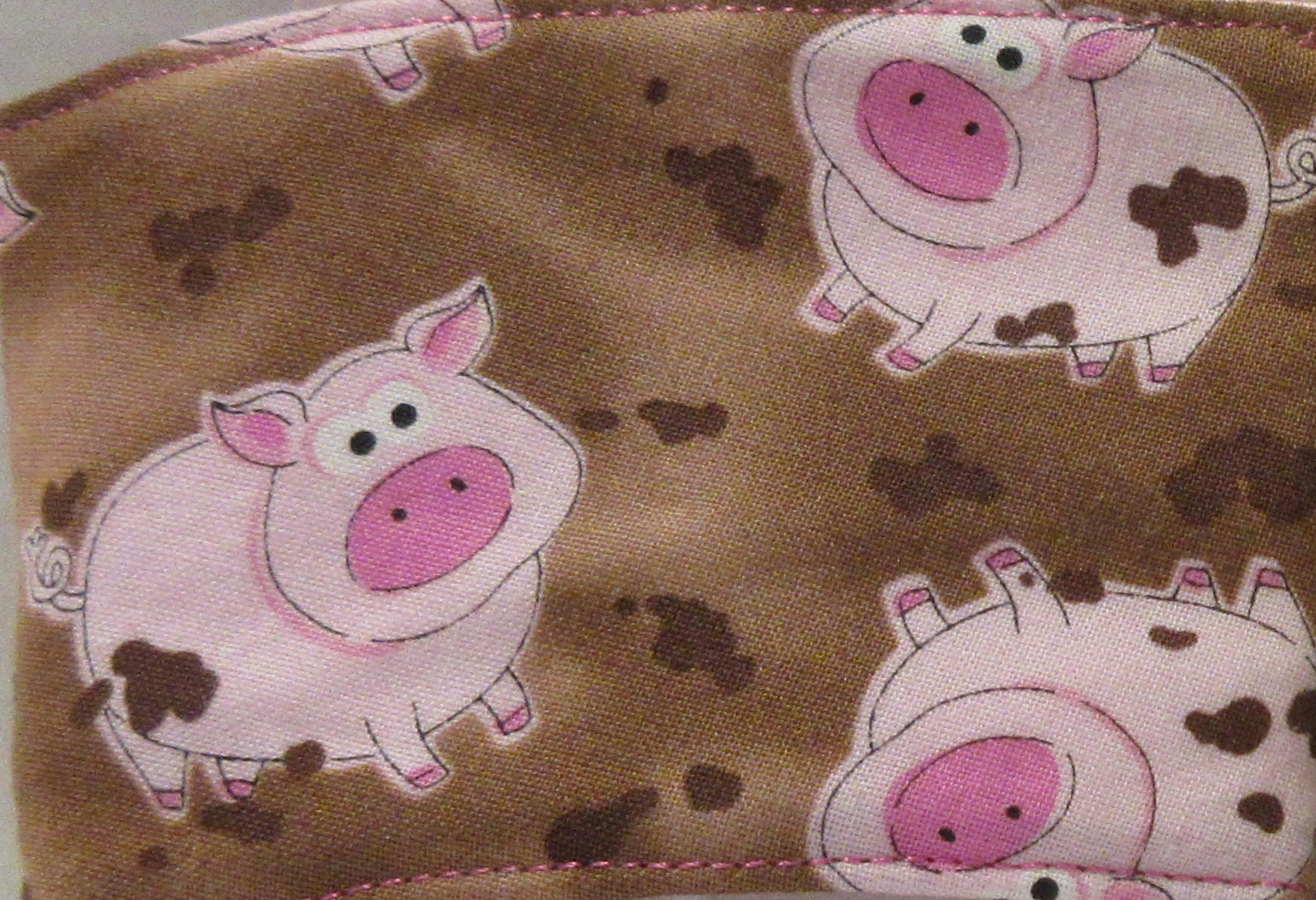 brown with pink pinks embroidered beverage sleeve