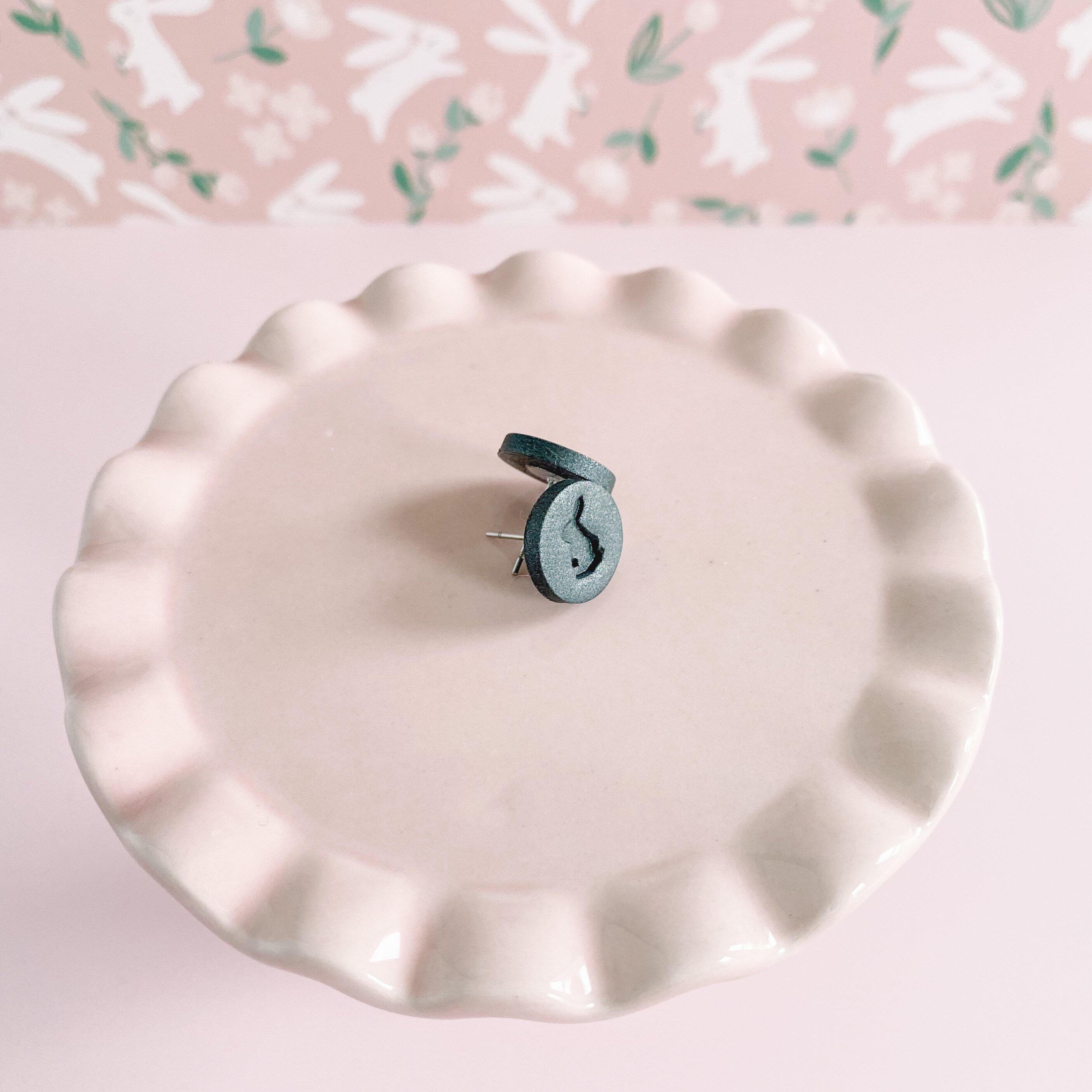 Grey Rabbit Stud Earrings on Pink Display