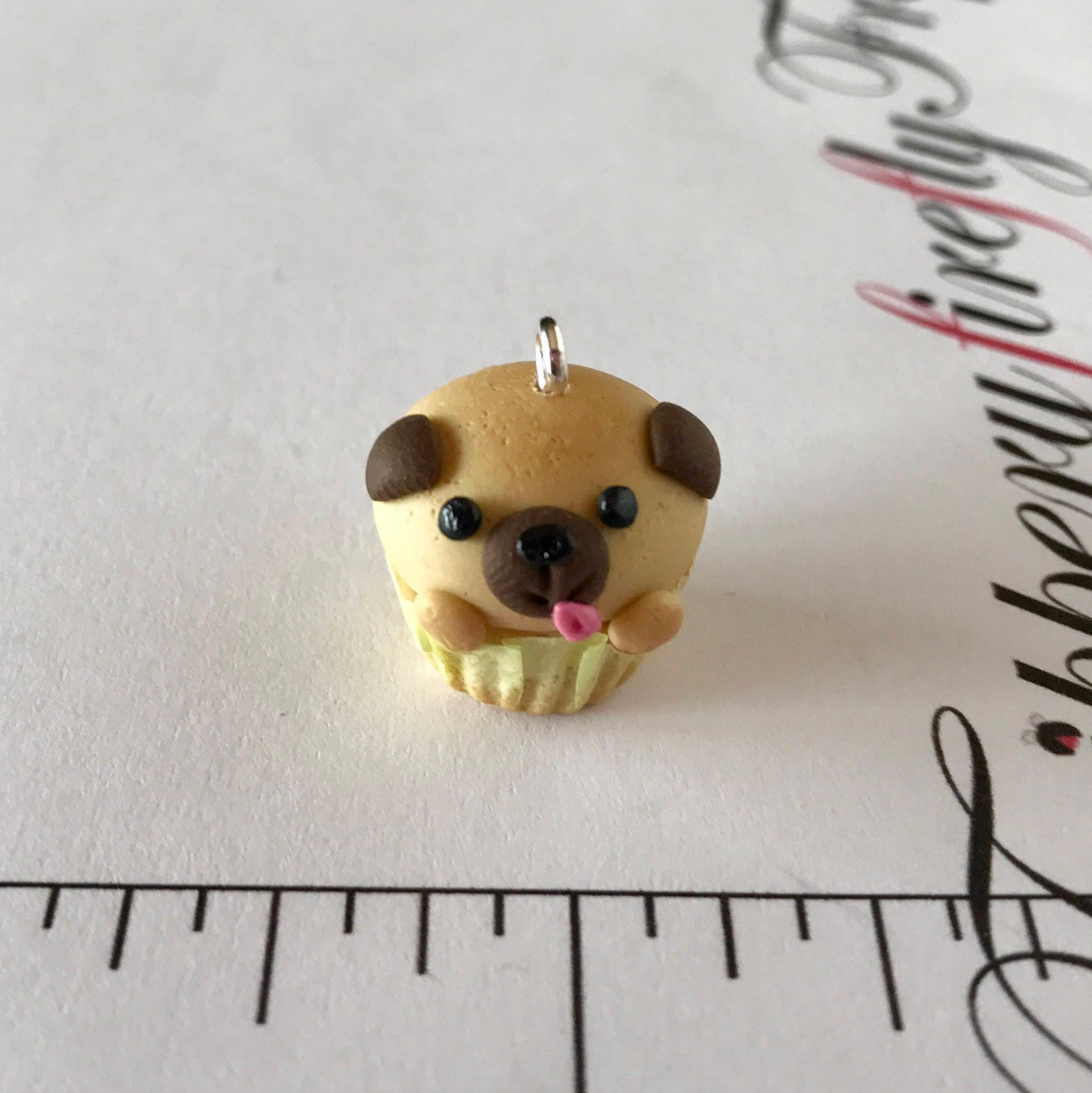 Pug cupcake in front of ruler