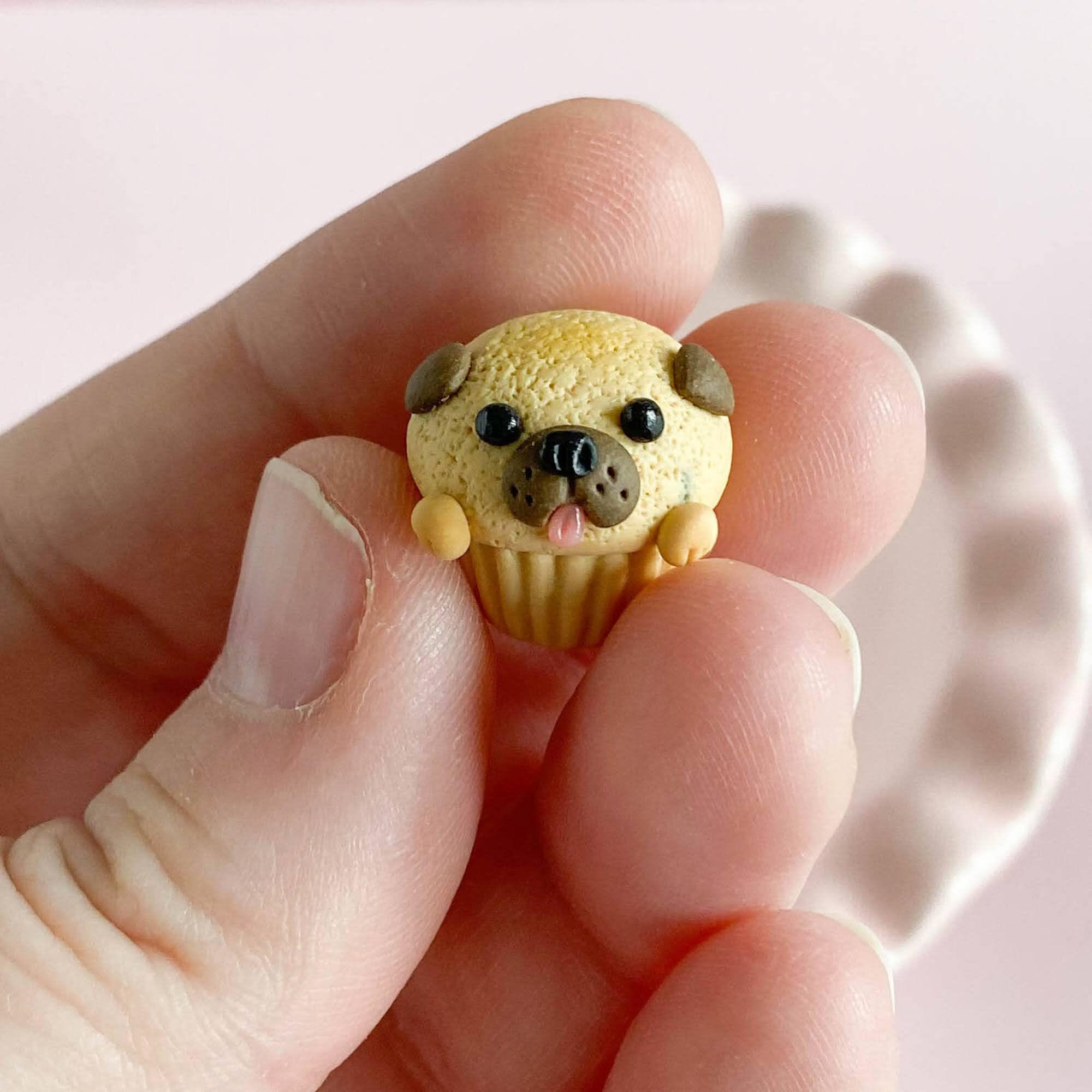 fireflyFrippery Tiny Pug Pupcake in hand