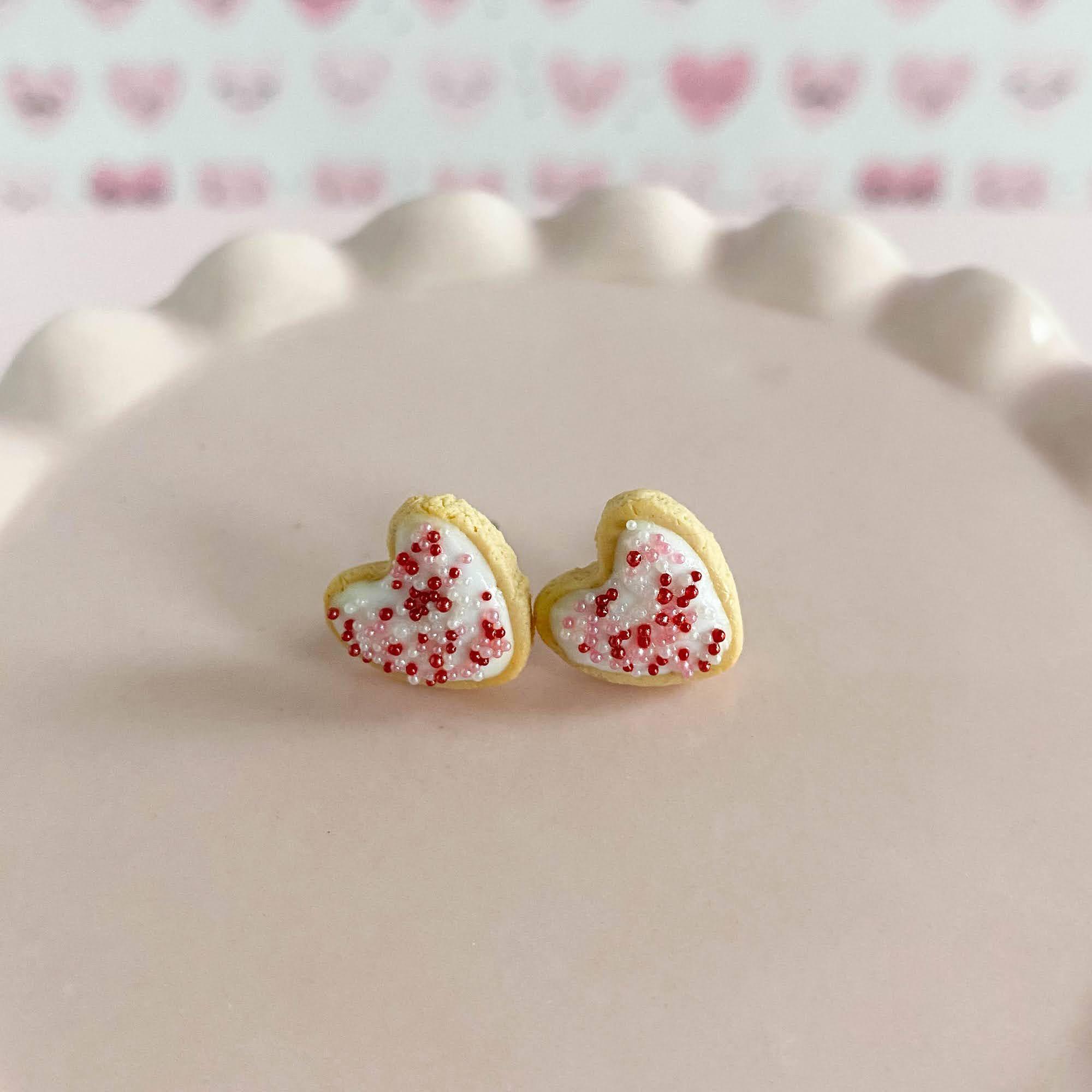 fireflyFrippery White Heart Sugar Cookie Earrings on Pink Display