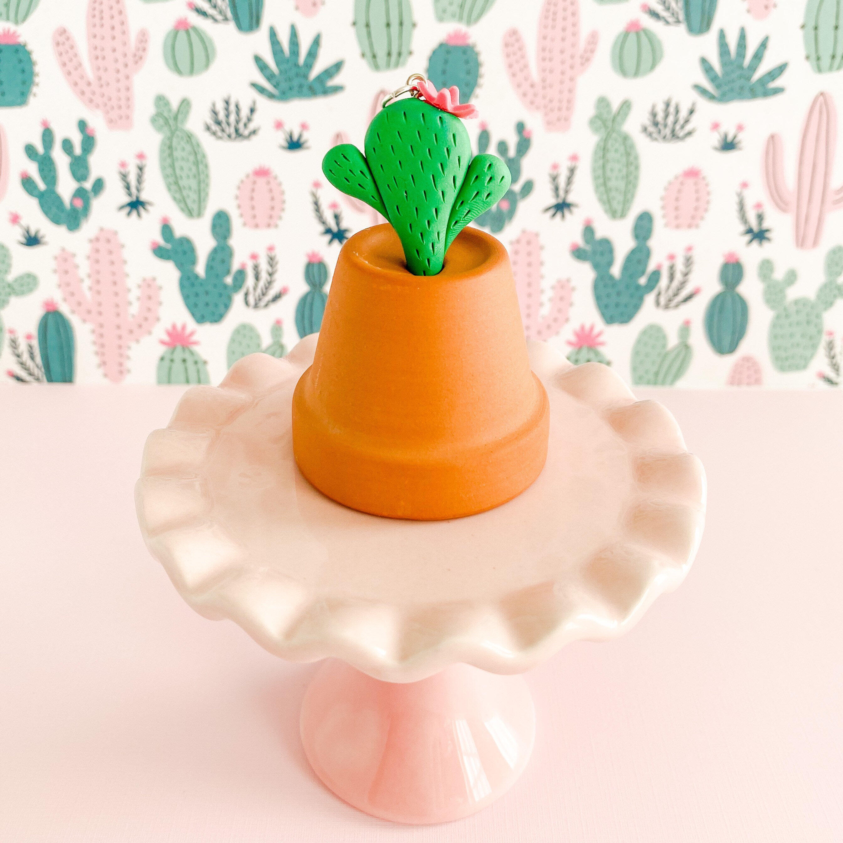 fireflyFrippery Cactus Charm with flower Displayed on Upside Down Miniature Terra Cotta Pot