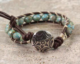 Western bracelet in brown leather with a silver star clasp