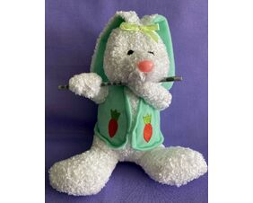 Plush Easter Bunny Flutist made of white chenille and wearing a green vest decorated with carrots. Playing a silver wood flute.