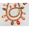 Charm necklace set   Vintage glass beads dangling from a strand of orange freshwater pearls