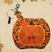 pumpkin shape dog poop bag holder big enough for keys cards masks when you go walking your dog .  Hand crafted in the USA by A Fur Baby Favorite